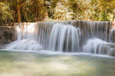 Natural deep forest waterfall