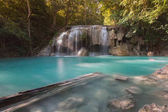 Beautiful natural blue stream waterfall in deep forest tropical jungle