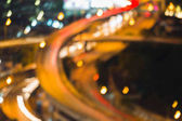 Aerial view close up blurred boke light highway intersection night view