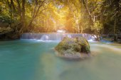 Sunlight effect over tropical water fall in deep forest jungle