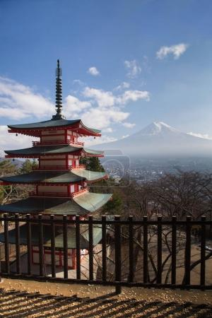 Red pagoda with Fuji volcano mountain and blue sky