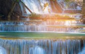 Close up multiple layers waterfall in tropical deep forest