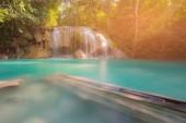 Erawan blue stream waterfall in tropical jungle, Thailand national park