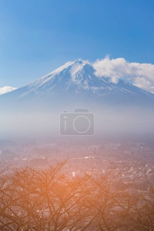 Fuji Mountain aerial view over small village, Japan natural landscape background