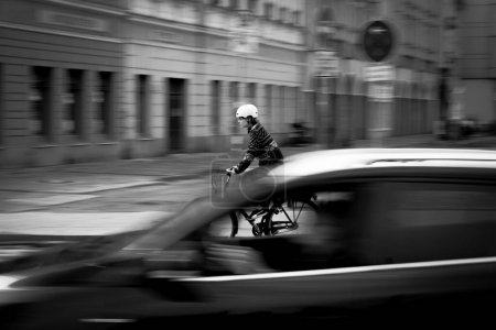 Photo for Panning of people riding a bike in Berlin - Royalty Free Image