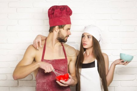 Man and girl on kitchen