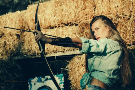 girl archer shooting with bow and
