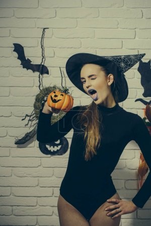 Halloween woman winking with blue lips and pumpkin