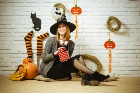 Halloween woman smiling with gift box and bag