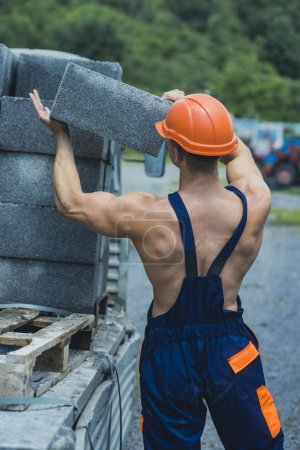 Sexy builder concept. Man or bodybuilder with big muscles.
