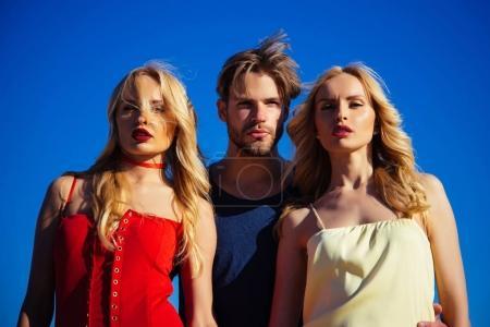 Twins women with macho on blue sky background. Lov...