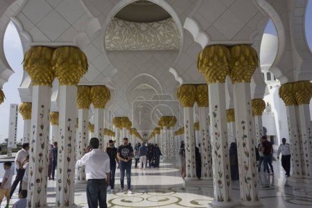 ABU DHABI, UAE - DECEMBER 28 2017: Mosque colonnade with people