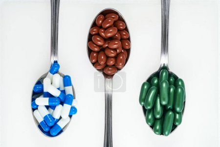 Medicines and food supplements on spoons