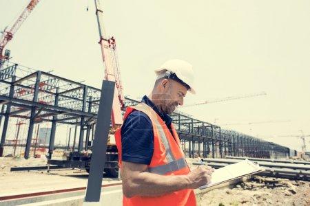engineer Worker writing building plan