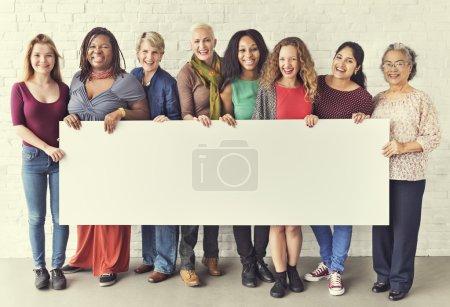 women holding informational board