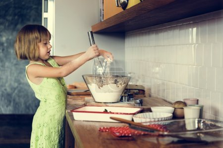 girl making dough for homemade cookies