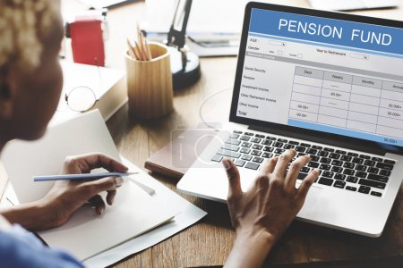 woman working on laptop with Pension Fund