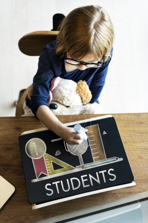 Photo for Kid Playing and drawing on blackboard, Education Concept, text: Students - Royalty Free Image