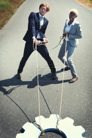 Business people pulling ropes