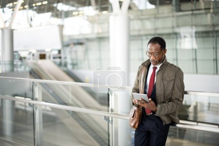 Man in Overcoat in Transport Terminal