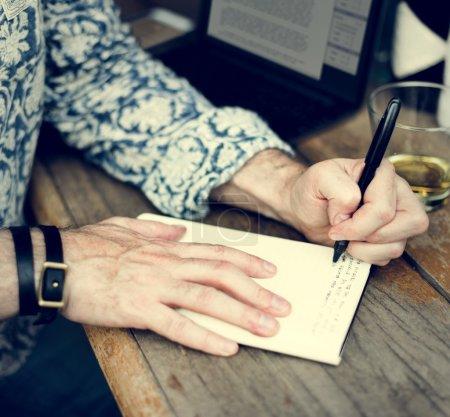Journalist man writing notes