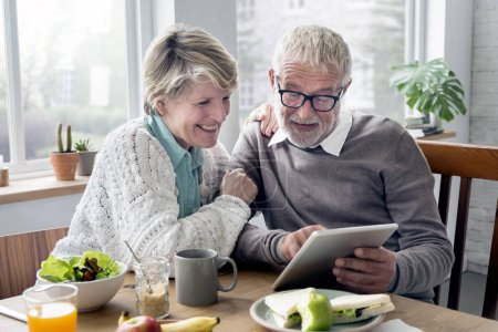 Senior Adults Holding Tablet