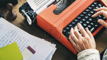 woman typing on vintage typewriter machine