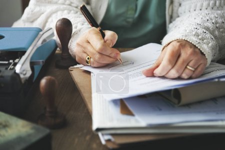woman writing on paper