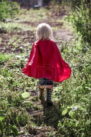 Superhero Little Boy at park