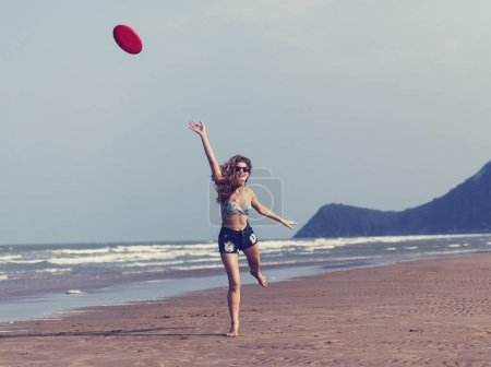 sportive woman playing Frisbee