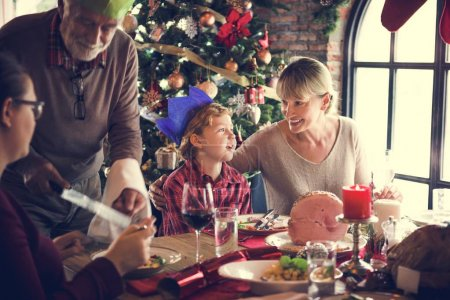 family at table with a festive dinner