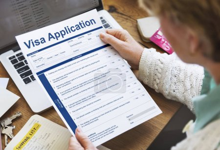 Senior woman with application form