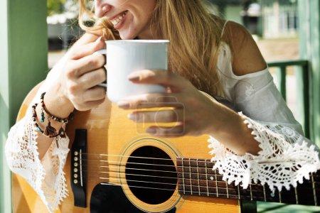 Guitarist woman drinking tea
