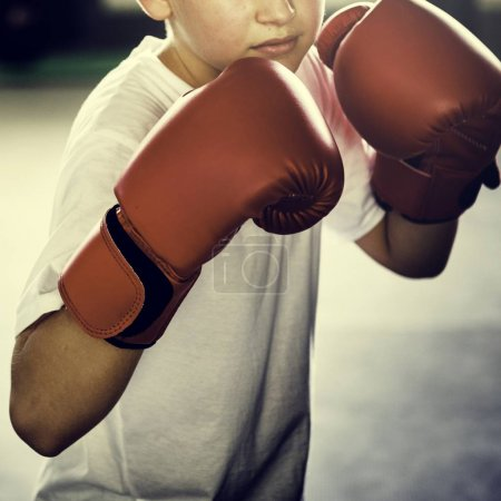 Boy Boxing in Gym