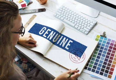 designer drawing in notebook