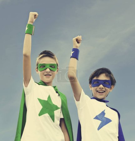 Kids in costumes superheroes