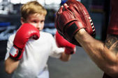 Boy Boxing in Gym