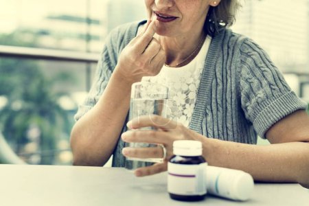 woman taking pills