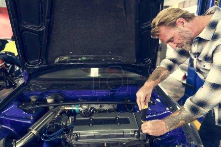 handsome car Mechanic in Garage