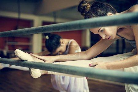 Ballerinas stretching in Ballet School