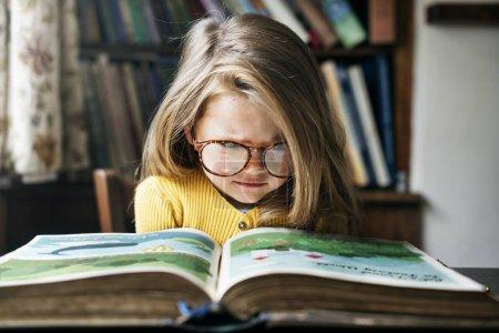Adorable Girl Reading book