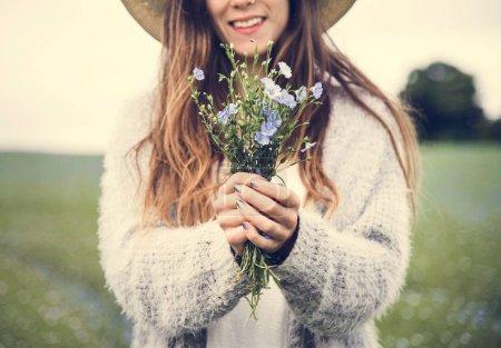 beautiful woman holding flowers