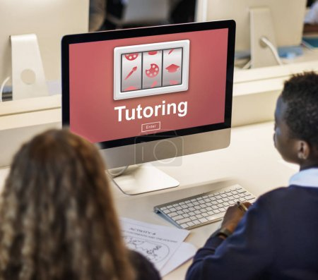 Classmate pupils using computer