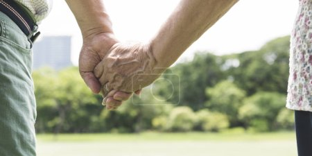Olderly Couple Holding Hands