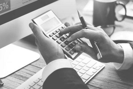 Businessman Accounting on calculator