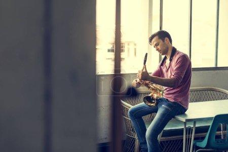 Handsome Jazzman holding Saxophone