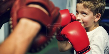 Boy Training Boxing with teacher