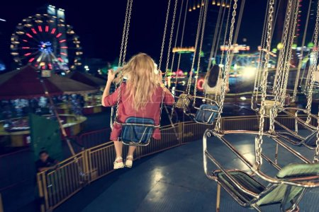 women on merry go round carousel