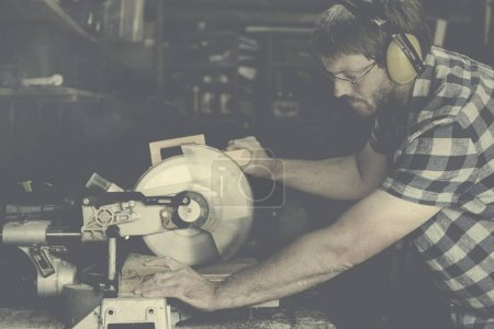 Carpenter Craftman in workshop