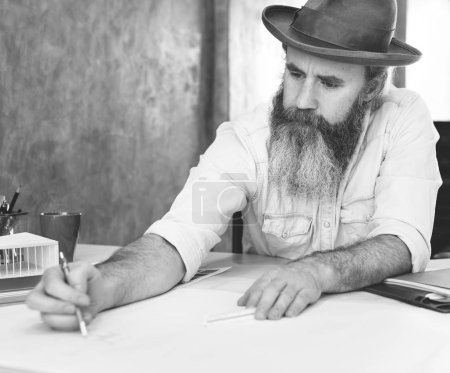 Man Architect working with Blueprint